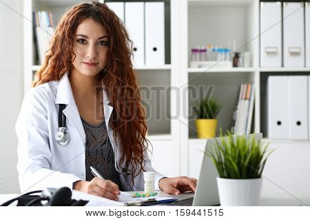 Beautiful Smiling Female Doctor Write Prescription