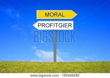 Signpost outside is showing Moral or Profit in german language