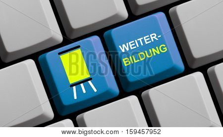 Blue computer keyboard with symbol showing Further Education in german language