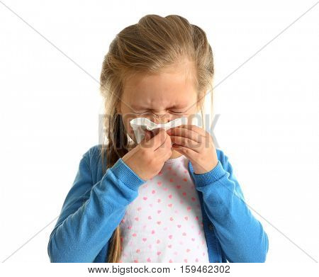 Cute little girl blowing nose on white background