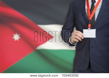 Businessman Holding Name Card Badge On A Lanyard With A National Flag On Background - Jordan