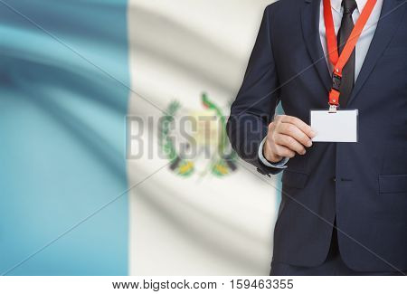 Businessman Holding Name Card Badge On A Lanyard With A National Flag On Background - Guatemala