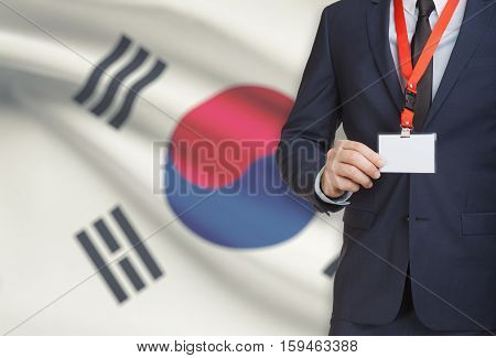 Businessman Holding Name Card Badge On A Lanyard With A National Flag On Background - South Korea