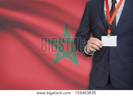 Businessman Holding Name Card Badge On A Lanyard With A National Flag On Background - Morocco