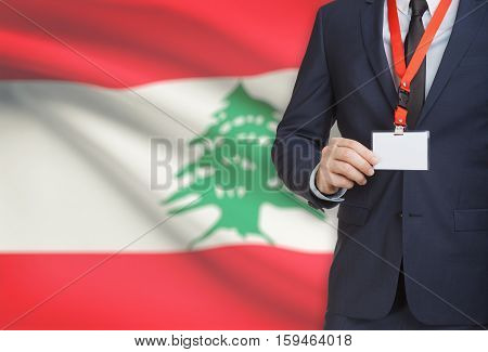 Businessman Holding Name Card Badge On A Lanyard With A National Flag On Background - Lebanon