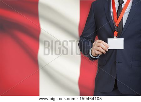 Businessman Holding Name Card Badge On A Lanyard With A National Flag On Background - Peru