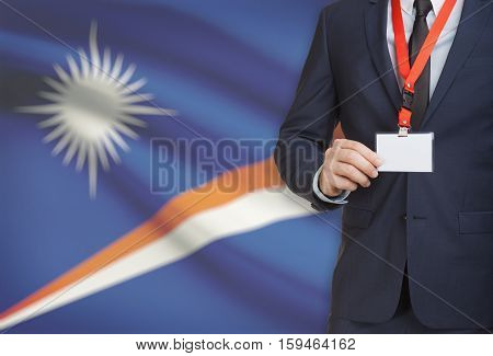 Businessman Holding Name Card Badge On A Lanyard With A National Flag On Background - Marshall Islan
