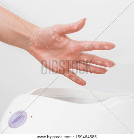Paraffin wax hand treatment, toned image, sqaure