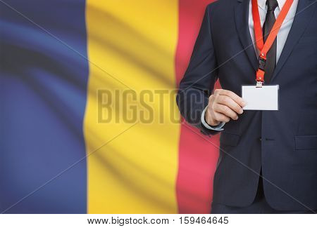 Businessman Holding Name Card Badge On A Lanyard With A National Flag On Background - Romania