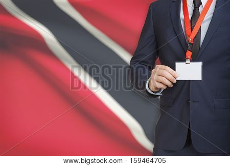 Businessman Holding Name Card Badge On A Lanyard With A National Flag On Background - Trinidad And T