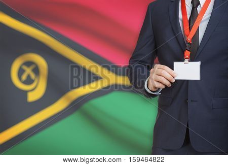 Businessman Holding Name Card Badge On A Lanyard With A National Flag On Background - Vanuatu