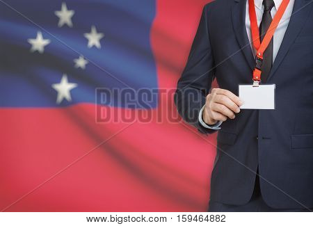 Businessman Holding Name Card Badge On A Lanyard With A National Flag On Background - Samoa