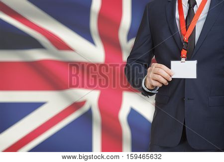 Businessman Holding Name Card Badge On A Lanyard With A National Flag On Background - United Kingdom