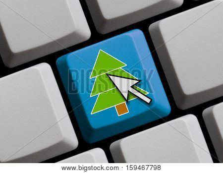 Christmas tree with mouse cursor on blue computer keyboard