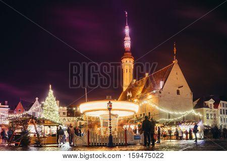 TALLINN ESTONIA - NOVEMBER 20 2016: Traditional christmas market in Tallinn old town. People enjoy winter holidays.