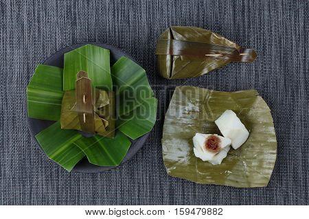 Thai dessert Steamed flour wrap sweet mashed coconut as Khanom Sai Sii in Thai.