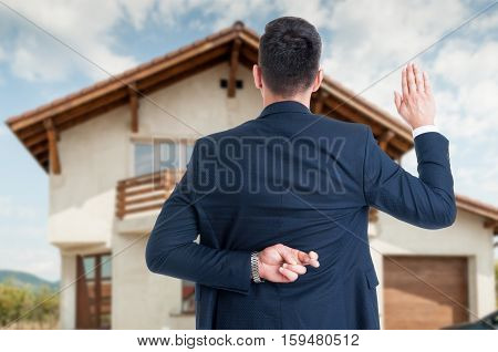 Back View Of Male Realtor With Finger Crossed