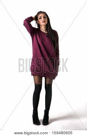 Beautiful female model, brunette. Isolated on white in studio shot. Full length photo