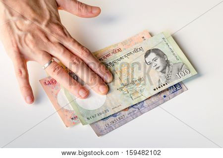 Woman Hand On Bhutanese Ngultrum Banknotes Currencies