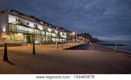 night view of the first coastline in the town of Sidmouth. Backlight. England Devon