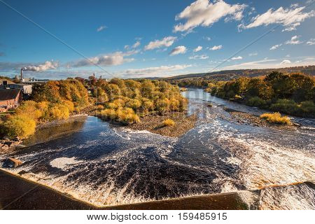 River Tyne below Hexham Bridge, and Weir on a sunny day in autumn