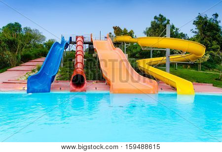 Empty colourful summer water slides and pool