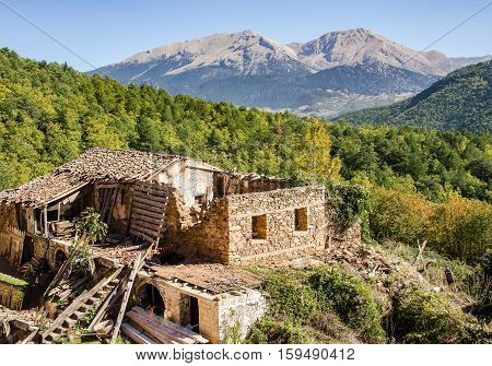 A ruined out leaning old abandoned house on mountain, Greece