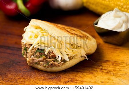 Venezuelan typical food Arepa with meat and chesse