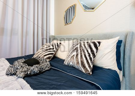 Bedroom interior with bed and pillow of cosy home in modern design. Vintage bedroom.
