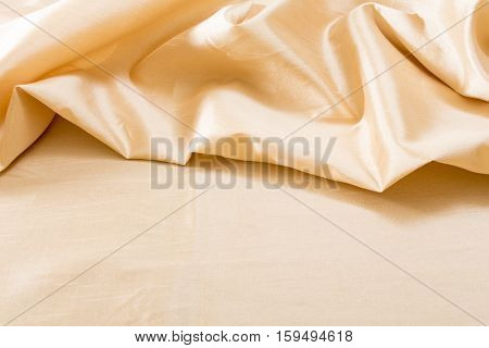 Golden wavy fabric texture / background .