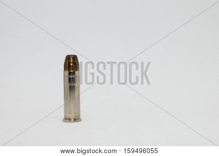 Bullet close-up on 38Super ammo isolated on white background