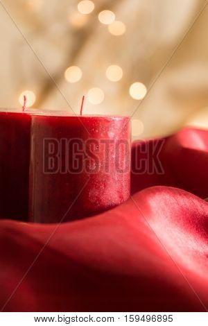Red Unused Candles, On Red Wavy Fabric And Golden Background With Bokeh.