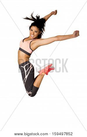 young attractive hispanic fitness trainer woman jumping high excited and happy wearing sport clothes isolated on white background in healthy lifestyle and body energy concept