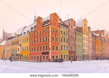 Multicolored traditional historical houses on Market square in the winter morning, Old Town of Wroclaw, Poland