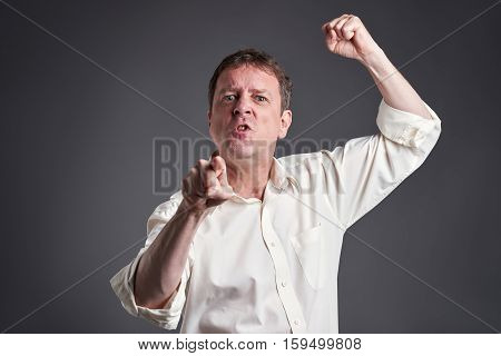 Portrait of a angry middle age man getting fury