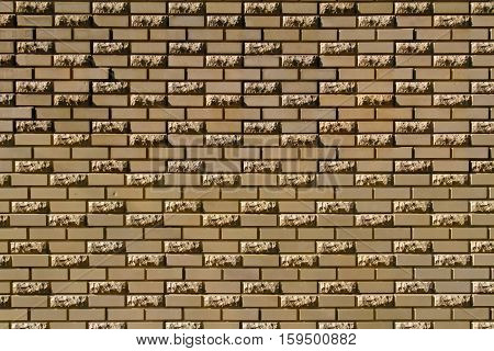 Brick wall made of light yellow facing bricks