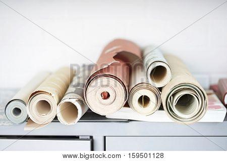 Rolls of wallpaper on desk