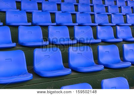 lines of blue stadium seats horizontal composition