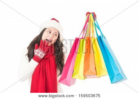 Happy Excited Female Shopper Showing Purchases With Santa Hat