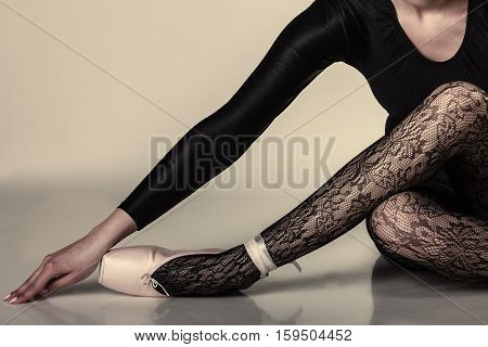 Graceful beautiful woman ballet dancer studio shot gray background