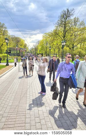 MOSCOW RUSSIA - May 02.2016: Citizens and tourists stroll in the Alexander Garden near the Kremlin