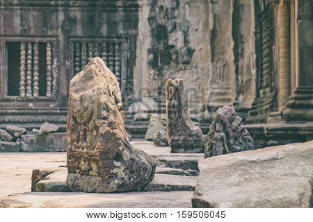 The ruined stone Lion guarding the ruins of Angkor Wat temple in the ancient city of Angkor, Siem Reap, Cambodia.