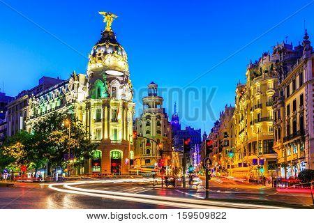 Madrid Spain. Gran Via main shopping street at dusk.