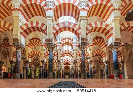 CORDOBA SPAIN - September 29 2016: Interior view of La Mezquita Cathedral in Cordoba Spain. Cathedral built inside of the former Great Mosque.