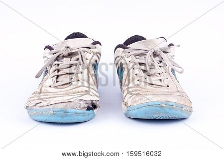 Old vintage damaged futsal sports shoes  on white background  isolated