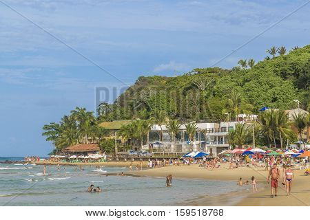 PIPA, BRAZIL, JANUARY - 2016 - Crowded beach in Pipa a touristic watering place located in Brazil South America