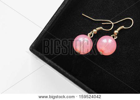 Pair of pink quartz earrings in black jewel box
