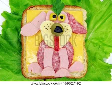 creative sandwich with cheese and salame dog shape
