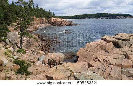 Rocky Coast in Maine:  Sheer cliffs and large granite boulders form the shoreline of Mount Desert Island in Acadia National Park.