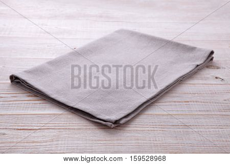 Napkin tablecloth on white wooden table. Empty napkin template. Unique perspectives horizontal.